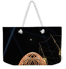 Weekender Tote Bag featuring the photograph The Moon Over The Egg by Mark Dodd