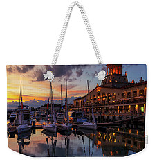 the nautical station and the yacht on the main sea channel of the Sochi seaport Weekender Tote Bag