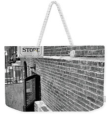Weekender Tote Bag featuring the photograph The Old Book Store by Karol Livote