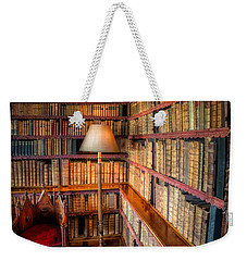 Weekender Tote Bag featuring the photograph The Old Library by Adrian Evans
