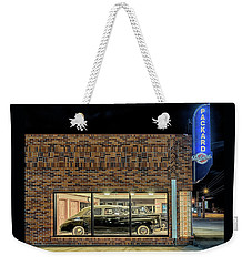 Weekender Tote Bag featuring the photograph The Old Packard Dealership by Susan Rissi Tregoning