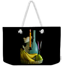 Weekender Tote Bag featuring the photograph The Orange Candle by Elf Evans