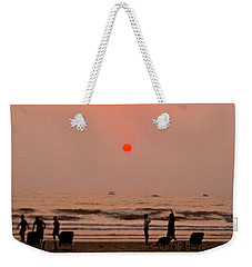 Weekender Tote Bag featuring the photograph The Orange Moon by Sher Nasser