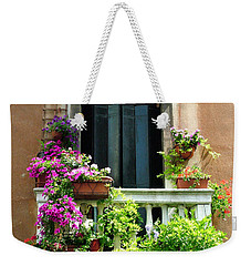Weekender Tote Bag featuring the photograph The Peach Wall With Fushia Flowers by Donna Corless