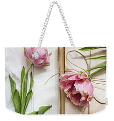 Weekender Tote Bag featuring the photograph The Pink Tulips by Kim Hojnacki