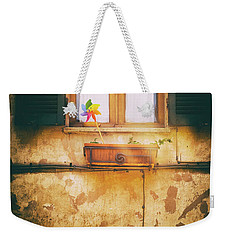Weekender Tote Bag featuring the photograph The Pinwheel by Silvia Ganora
