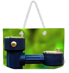 Weekender Tote Bag featuring the photograph The Quencher by Paul Wear
