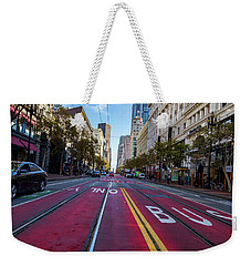 Weekender Tote Bag featuring the photograph The Red Path by Darcy Michaelchuk