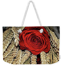 Weekender Tote Bag featuring the photograph The Red Rose On A Bed Of Wheat by Diana Mary Sharpton
