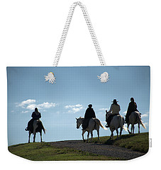 Weekender Tote Bag featuring the photograph The Ride by Tim McCullough