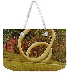 Weekender Tote Bag featuring the photograph the rings of Mactown by Aaron Martens