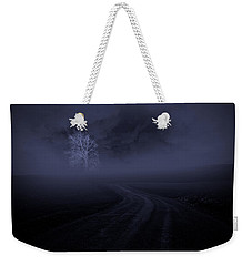 Weekender Tote Bag featuring the photograph The Road by Robert Geary
