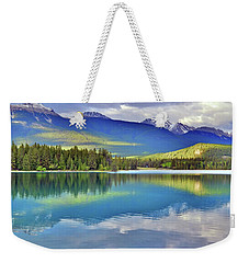 Weekender Tote Bag featuring the photograph The Rockies Reflected In Lake Annette by Tara Turner