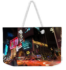 Weekender Tote Bag featuring the photograph The Running Of The Taxis by Alex Lapidus