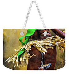 Weekender Tote Bag featuring the photograph The Samba Dancer by Chris Lord