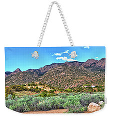 Weekender Tote Bag featuring the photograph The Sandias by Gina Savage