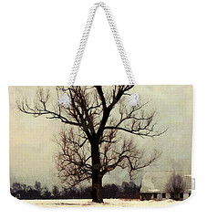 Weekender Tote Bag featuring the photograph The Sentinel - Lone Winter Tree by Janine Riley