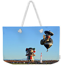 Weekender Tote Bag featuring the photograph The Serenade by AJ Schibig