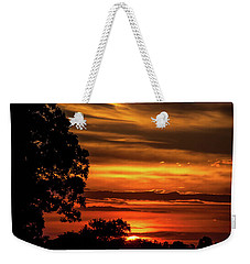 Weekender Tote Bag featuring the photograph The Setting Sun by Mark Dodd