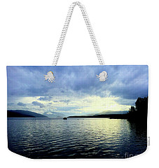 Weekender Tote Bag featuring the photograph The Silver Linings by Victor K