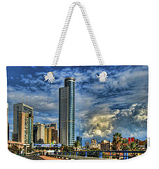 The Skyscraper And Low Clouds Dance Weekender Tote Bag by Ron Shoshani