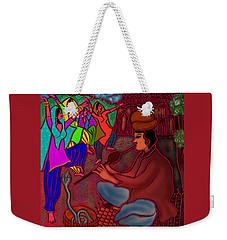 Weekender Tote Bag featuring the digital art The Snake Charmer by Latha Gokuldas Panicker