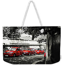 Weekender Tote Bag featuring the photograph The Street Of Red Cars by Jenny Rainbow