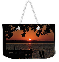 Weekender Tote Bag featuring the photograph The Sun Rises Over The Bay by Mark Dodd