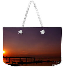 The Sun Sets Over The Water Weekender Tote Bag