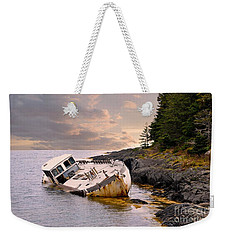 Weekender Tote Bag featuring the photograph Shipwrecked by Elaine Manley