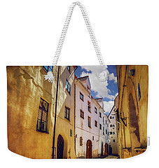 Weekender Tote Bag featuring the photograph The Sunny Streets Of Old Riga  by Carol Japp