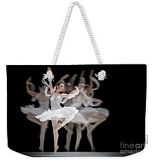 Weekender Tote Bag featuring the photograph The Swan Ballet Dancer by Dimitar Hristov