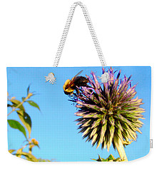 Weekender Tote Bag featuring the photograph The Thistle And The Bee. by Roger Bester