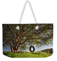 The Tire Swing Weekender Tote Bag by Endre Balogh