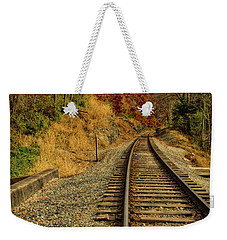 Weekender Tote Bag featuring the photograph The Tracks In The Fall by Mark Dodd