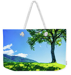 Weekender Tote Bag featuring the photograph The Tree On The Hill by Silvia Ganora