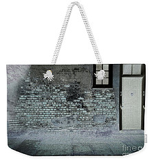 Weekender Tote Bag featuring the photograph The Wall by Douglas Stucky