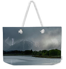 Weekender Tote Bag featuring the photograph The Warning by Sandra Bronstein