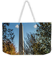 Weekender Tote Bag featuring the photograph The Washington Monument In Fall by Ed Clark
