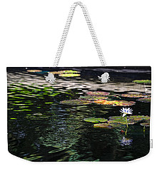 Weekender Tote Bag featuring the photograph The Water Lily by Cendrine Marrouat