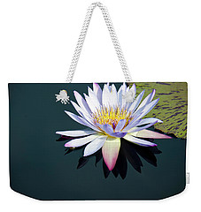 Weekender Tote Bag featuring the photograph The Water Lily by David Sutton