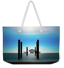 Weekender Tote Bag featuring the photograph The West Pier Ruins In Winter Light by Chris Lord