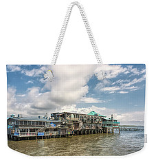 Weekender Tote Bag featuring the photograph The Wharf At Cedar Key by John M Bailey