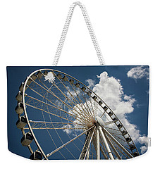 Weekender Tote Bag featuring the photograph The Wheel And Sky by Greg Mimbs