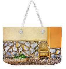 Weekender Tote Bag featuring the photograph The Wicker Chair. by Gary Gillette