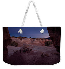 Weekender Tote Bag featuring the photograph The Window In Desert by Edgars Erglis