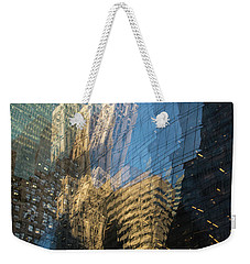 Weekender Tote Bag featuring the photograph The World Keeps Turning by Alex Lapidus