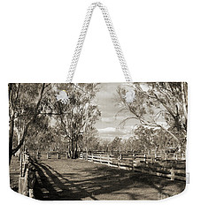 Weekender Tote Bag featuring the photograph The Yards by Linda Lees