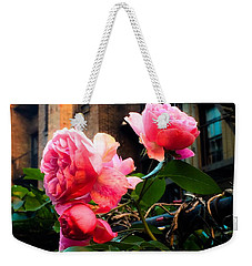 Weekender Tote Bag featuring the photograph There Is A Rose In Spanish Harlem by Miriam Danar