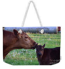 Weekender Tote Bag featuring the photograph There Is Somthing In Your Ear by Mark McReynolds